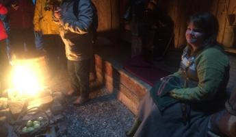 Gathering around a longhouse hearth